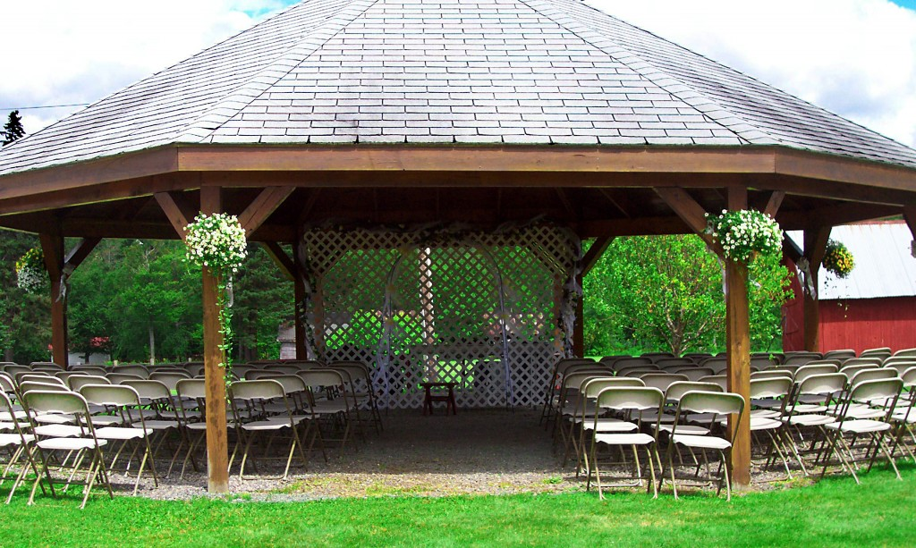 Wedding ceremony in outdoor gazebo on lakeside property in Vermont