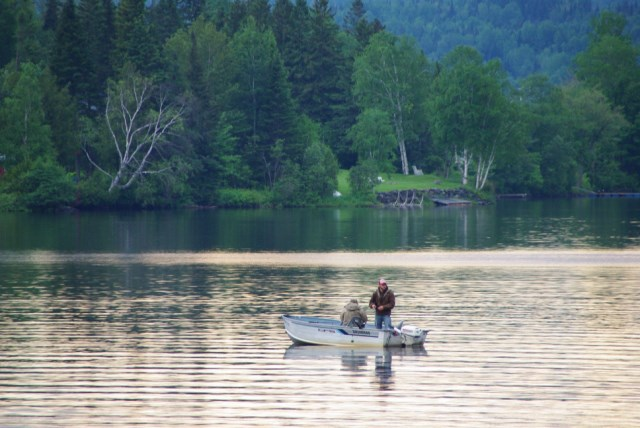 Fishermen fishing on Lake Wallace in their boat at Jackson's Lodge
