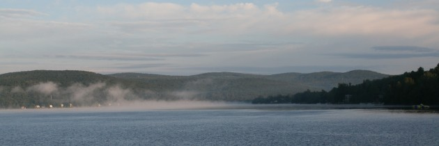 A summer sunrise, with the fog rolling away and the water heating up on Lake Wallace.
